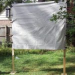 DIY screen with white bedsheet